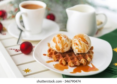 Christmas breakfast. Viennese wafer biscuit with ice-cream and coffee with milk