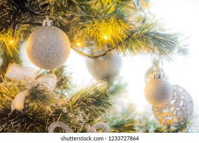 Christmas bulbs and decorations on christmas tree