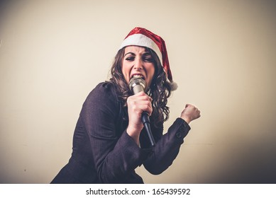 christmas businesswoman singing with microphone on white background