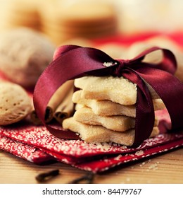 Christmas butter cookies with brown sugar. Symbolic image. Christmas background. Wooden background. Close up.