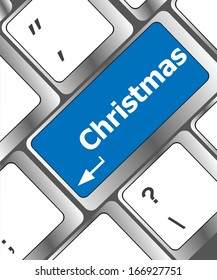 christmas button on the keyboard key - holiday concept