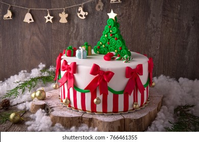 Christmas cake decorated with sweet figures of  Christmas tree, Santa, bears, deer, fir-tree, sleigh
