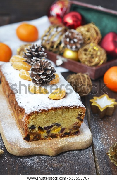 Christmas cake with dried fruits and tangerines