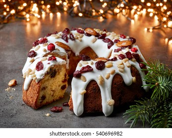 christmas cake with fruits and nuts on grey table