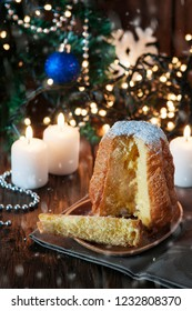 Christmas cake panetone and snow on the wooden table, selective focus