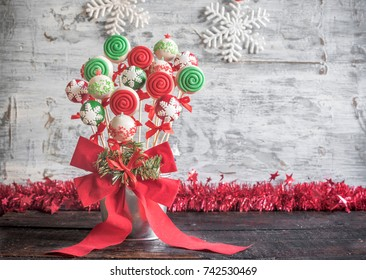 Christmas cake pops served on wooden background with blank space,selective focus