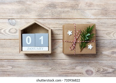 Christmas calendar. Christmas gift, fir branches on wooden white background. Copy space, top view.
