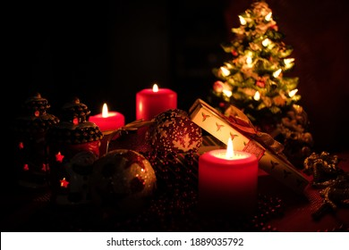 Christmas candle and decoration on black background. High quality photo