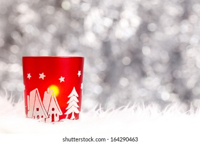 Christmas candle holder on the left side over grey background