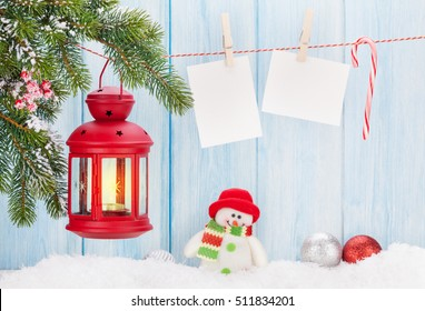 Christmas candle lantern and blank photo frames