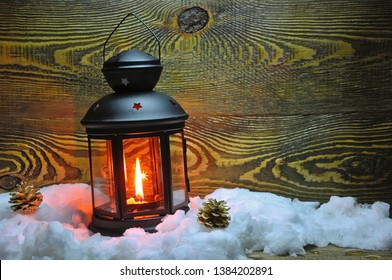 Christmas Candle Lantern With A Wooden Background