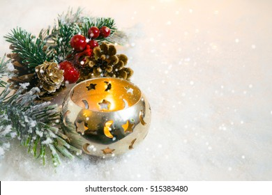 Christmas candle on the snow, with christmas decorations