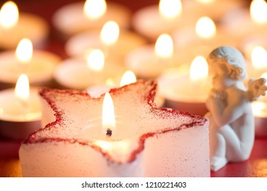 Christmas candle star and angel abstract background in night