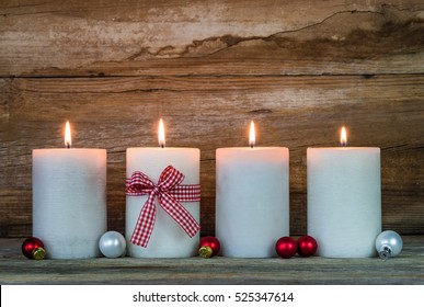 Christmas candles, advent decoration, four flames burning.