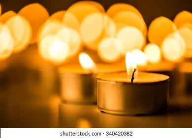 Christmas candles burning at night.