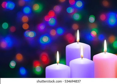 Christmas candles and lights. Fourth Sunday in Advent. Angel Candle. Decoration on a dark background.