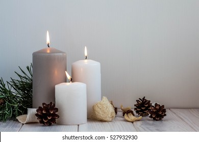 Christmas candles and lights on a old wooden table