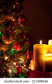 Christmas candles on fir tree lights background
