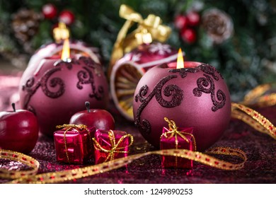 Christmas candles with ornaments