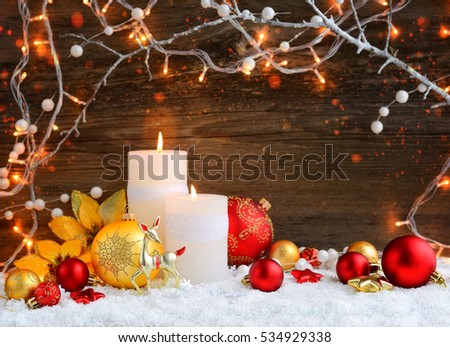 christmas candles with christmas ornaments and christmas lights festive christmas background