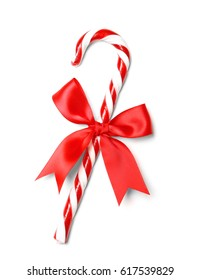 Christmas candy cane with bow isolated on white