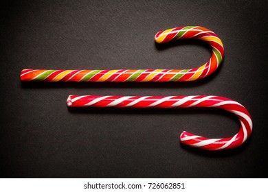 Christmas candy cane on a dark surface