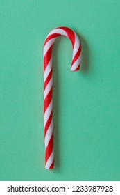 Christmas Candy cane on green Background