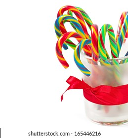 Christmas candy canes on white background