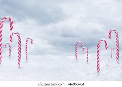 Christmas candy peppermint cane with snowfall on blue clouds background