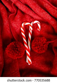 Christmas cane  on fabric background.