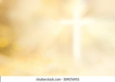 Christmas card background: Blur gold cross symbol for christian and catholic.