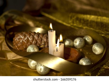 Christmas card with Christmas balls, ribbons, candles and pinecone