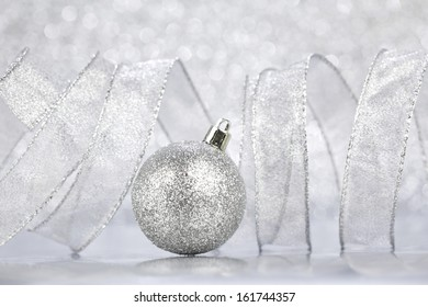 Christmas card with beautiful decoration on silver background