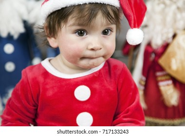 Christmas card: beautiful Christmas tree, decorated with toys, New Year , child in a costume dwarf.