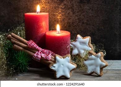 Christmas card with cinnamon stars and cinnamon sticks