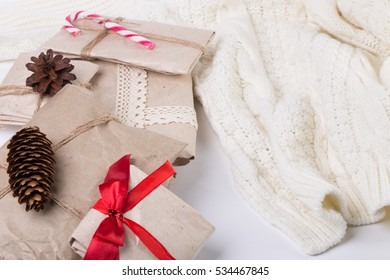Christmas card concept with gift boxes and knitted sweater. New Year's decoration background
