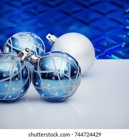 Christmas card. A  decorative balls on a blue background.