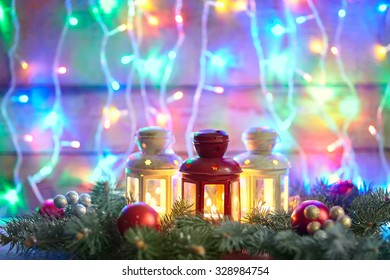 Christmas card with fir tree and decoration on lights bokeh background with copy space