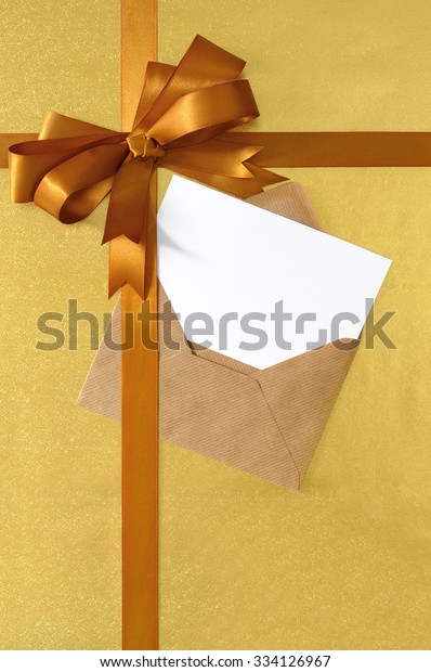 Christmas card, gold diagonal gift ribbon bow, shiny paper background, copy space, vertical