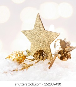 Christmas card with golden star and decorations on Defocused Christmas Bokeh twinkling lights background