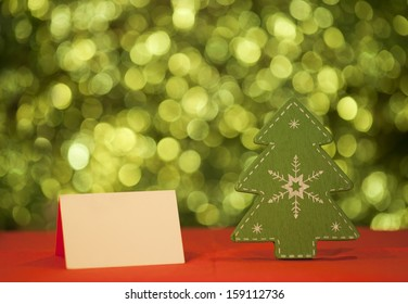 christmas card with green wooden tree on green background