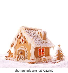 Christmas card. Holiday Gingerbread house isolated on white.