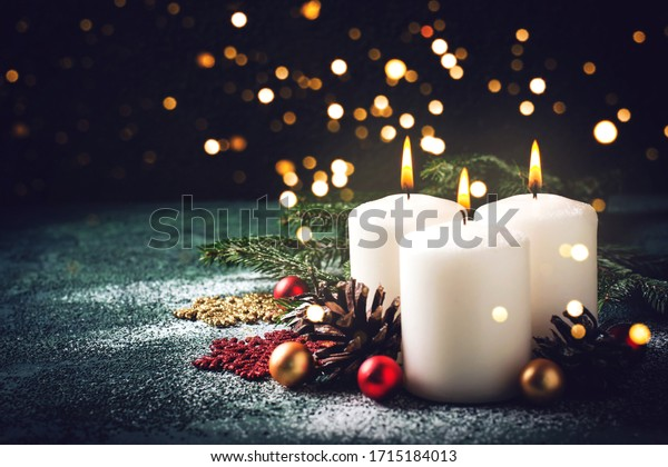Christmas card with holiday mood. Festive burning candles. Natural and reusable decor.