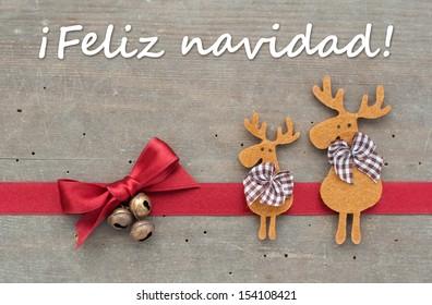 christmas card with reindeer/Merry Christmas/spanish