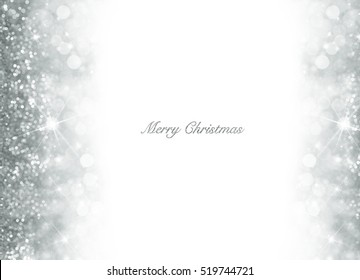 Christmas card with silver glitter scattered as a left hand border and right decoration over white with copy space for your greeting