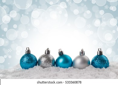 Christmas card small blue and silver balls over blurred background,soft focus