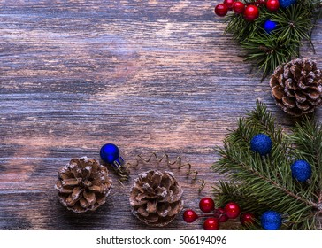 Christmas card with tree decorations and glass candlestick  on th wooden background. Marry Christmas