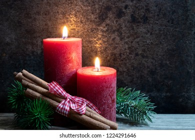 Christmas card-with red candles and cinnamon sticks