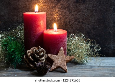Christmas card-with red candles and natural material