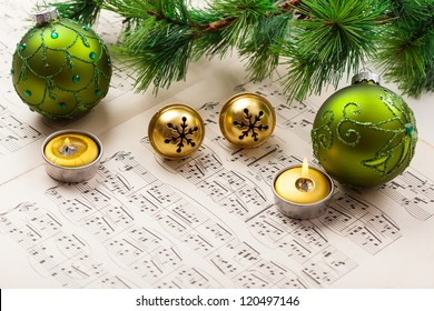 Christmas carol with jingle bells and candles